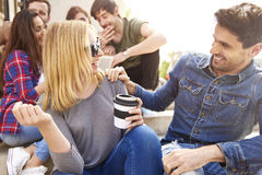 Group of young people having a good time Royalty Free Stock Photo