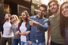 Group of young people having a good time. This is where we are going Royalty Free Stock Image