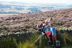 Group Of Young People Hiking Through Countryside Royalty Free Stock Photography