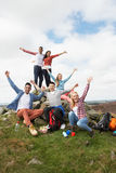 Group Of Young People Hiking In Countryside Stock Photography