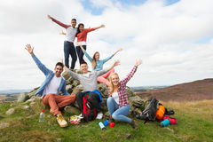 Group Of Young People Hiking In Countryside Stock Photos
