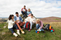 Group Of Young People Hiking In Countryside Royalty Free Stock Images