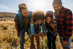 Group of young people hiking in nature and taking pictures Royalty Free Stock Photo