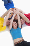 Group of young people holding hands Royalty Free Stock Photos