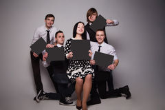 Group of young people holding sheets of paper Royalty Free Stock Images