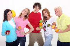 Group of young people holding some fruit Royalty Free Stock Photo