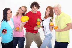 Group of young people holding some fruit. Young people isolated on white Stock Photos