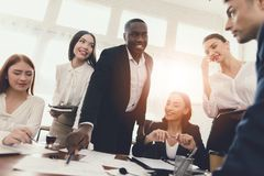 A group of young people holds brainstorming in the office. They work in a call center and discuss business issues royalty free stock photos