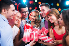 Group of young people with holiday gifts Royalty Free Stock Photos