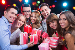 Group of young people with holiday gifts Stock Images