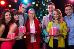 Group of young people with holiday gifts Royalty Free Stock Photo