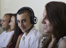 Group of young people indoors Royalty Free Stock Image