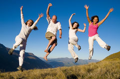 Group Young People Jumping Field Concept.  Stock Photo