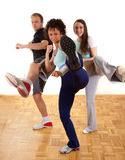 Group of young people kicking as exercise Royalty Free Stock Photo