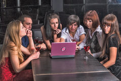 Group of young people with laptop in cafe Stock Photo