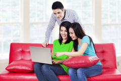Group of young people on a laptop Stock Image