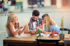 Group of young people laughing in cafe enjoying Royalty Free Stock Photo