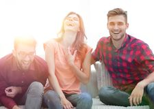 Group of young people laughing and sitting on the couch. Photo with copy space Royalty Free Stock Photo