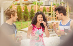 Group of young people laughing in summer party Stock Photos