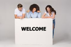 Group of young people look at banner stock photo