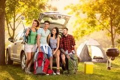 Group of young people making selfie portrait on camping trip. Group of young people arrived on camping trip and making selfie portrait stock image