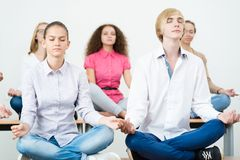 Group of young people meditating Royalty Free Stock Photography