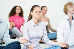 Group of young people meditating Royalty Free Stock Photo