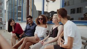 Group of young people meeting at cafe stock footage