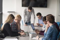 Group of young people meeting in startup office royalty free stock photography