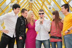 Group of young people with microphone Stock Image