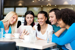 Group of young people in modern cafe Stock Photos
