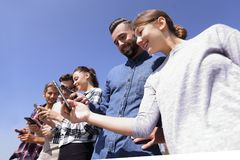 Group of young people with modern gadgets. Closeup of a group of young people with modern gadgets Royalty Free Stock Photo