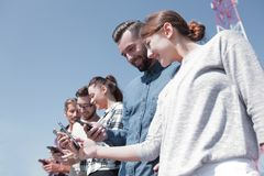 Group of young people with modern gadgets. Closeup of a group of young people with modern gadgets Stock Photos