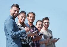 Group of young people with modern smartphones. Communication concept Stock Image