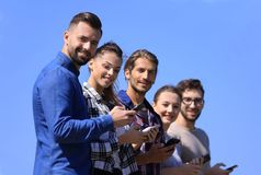 Group of young people with modern smartphones. Communication concept Stock Photography
