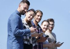 Group of young people with modern smartphones. Communication concept Royalty Free Stock Image