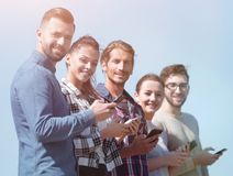 Group of young people with modern smartphones. Communication concept Royalty Free Stock Photos