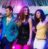 Group of young people at night club Stock Photo