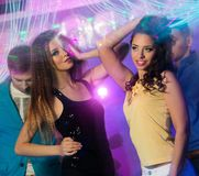 Group of young people at night club. Group of happy young people dancing at night club Royalty Free Stock Images