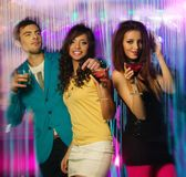 Group of young people at night club. Group of happy young people dancing at night club Stock Photo