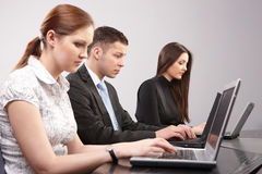 Group of young people in the office working togeth Royalty Free Stock Photos