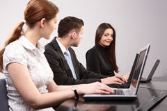 Group of young people in the office working togeth royalty free stock photo