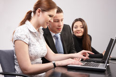 Group of young people in the office working togeth royalty free stock images