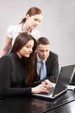 Group of young people in the office working togeth royalty free stock image