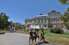 Group of young people, the opera theater in the background Royalty Free Stock Photos
