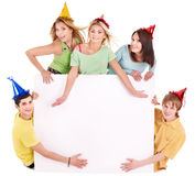 Group of young people in party hat. Royalty Free Stock Photo
