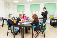 Group of young people playing board games Stock Photography