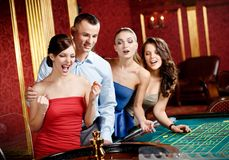 Group of young people playing roulette Royalty Free Stock Images