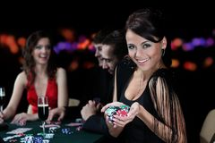 Group of young people playing roulette at the gambling house Stock Images
