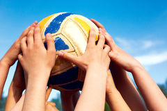 Group of young people playing volleyball Stock Photo